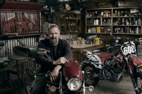 Dale general shedder and his Triumph motorcycle environmental portrait